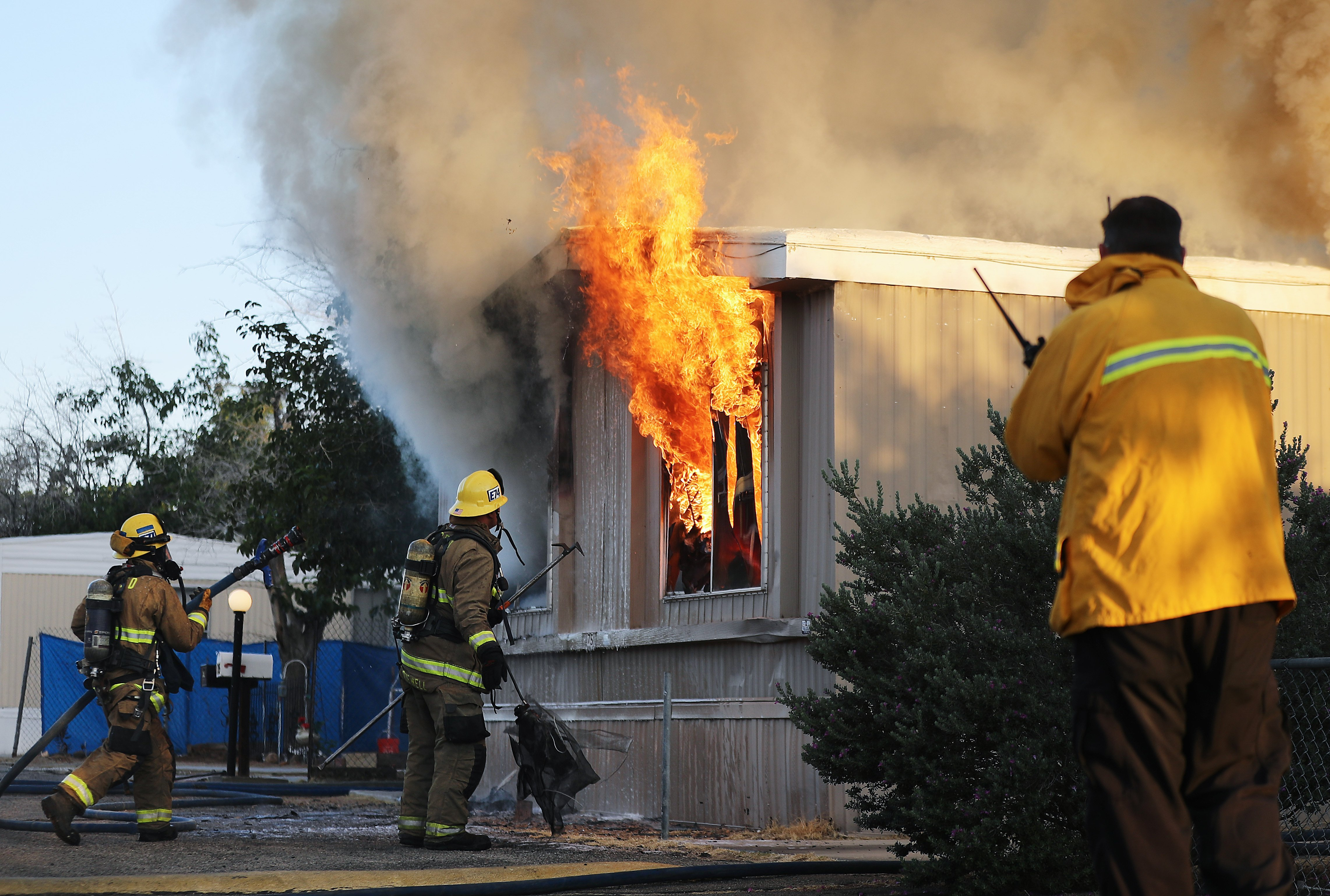 Firefighters trying to put out a house fire the a 7.1 magnitude earthquake in Ridgecrest, California   Photo: Getty Images