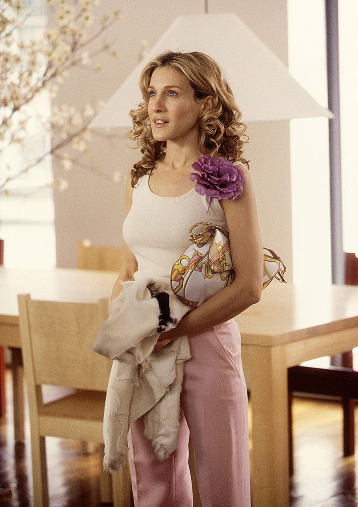 """""""Sex and the City"""" star Sarah Jessica Parker in a pastel pink and white blouse ensemble. Photo: Getty Images"""