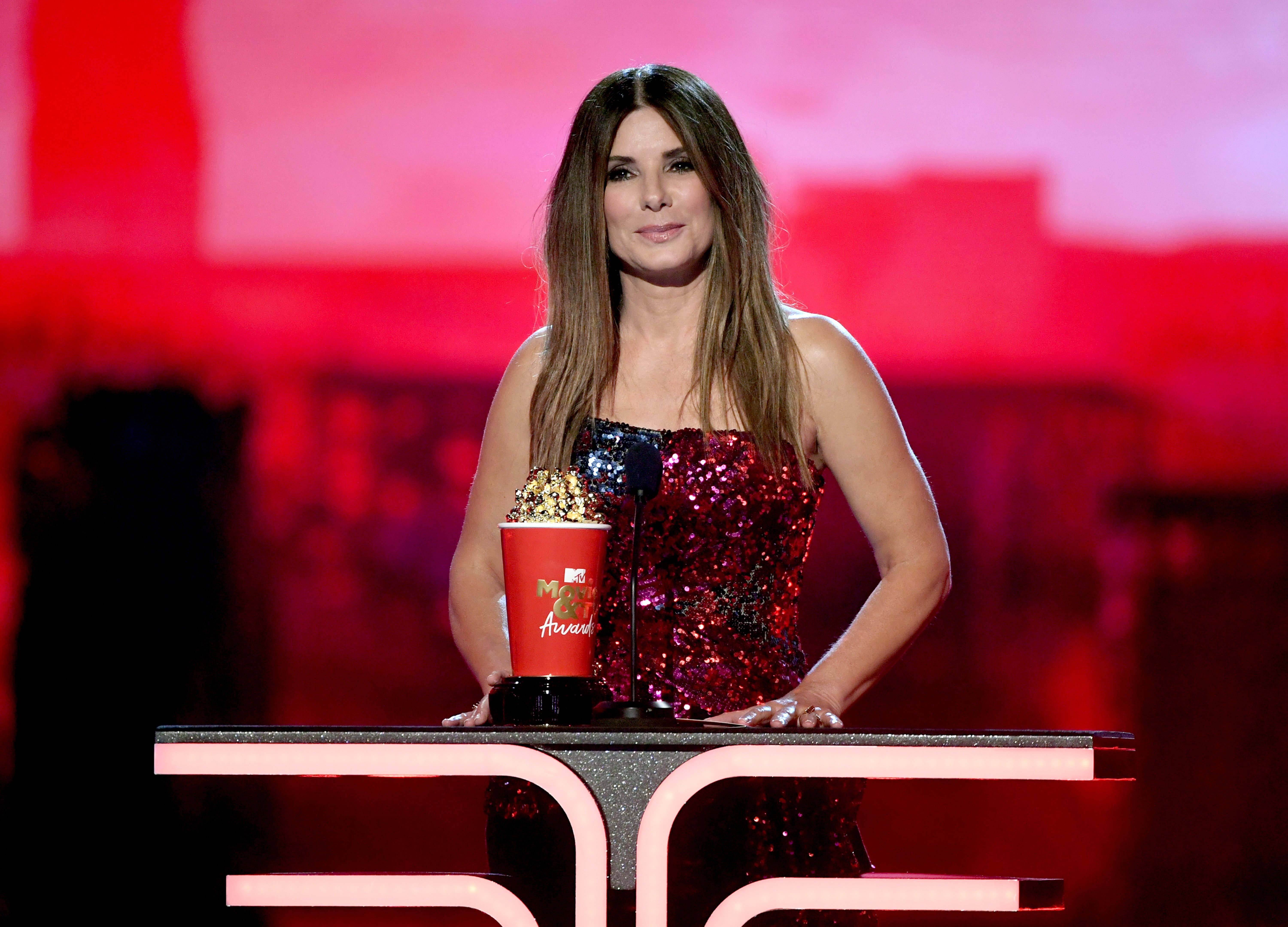 Sandra Bullock accepts the Most Frightened Performance award for 'Bird Box' onstage during the 2019 MTV Movie and TV Awards at Barker Hangar on June 15, 2019, in Santa Monica, California. | Source: Getty Images.