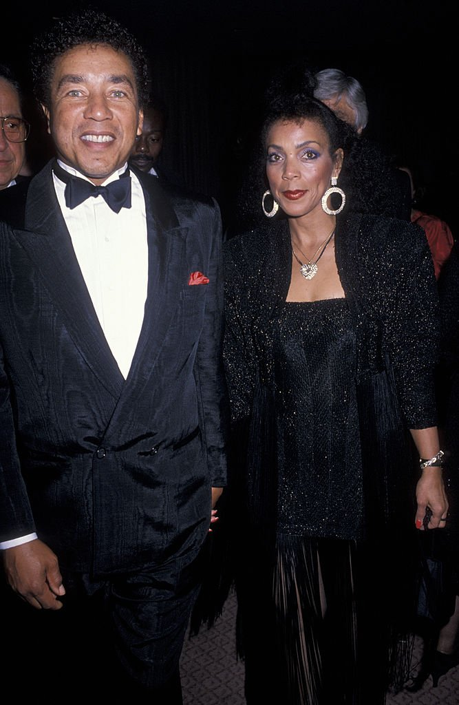 Smokey Robinson and Claudette Rogers at the 21st Annual Songwriter's Hall of Fame, 1990  in New York | Source: Getty Images