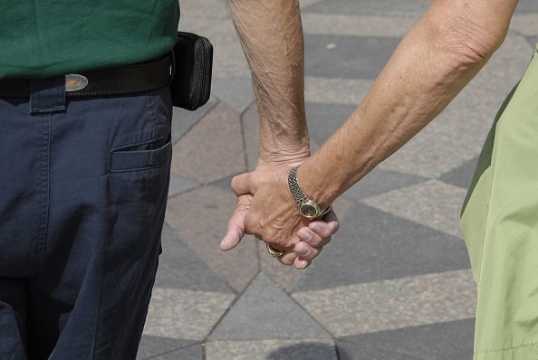 Elderly couple holding hands | Photo: Getty Images