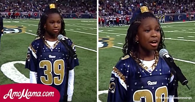 Girl about to sing the national anthem. As soon as she opened her mouth, the crowd froze