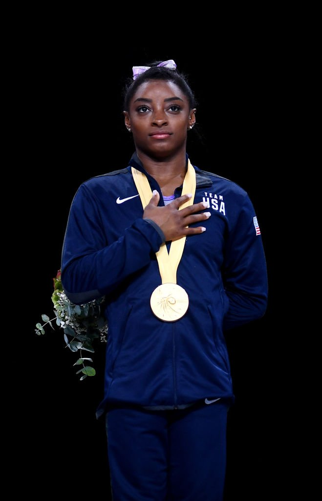 Gold medalist Simone Biles of The United States on the podium following the Women's Floor Final during day | Photo: Getty Images