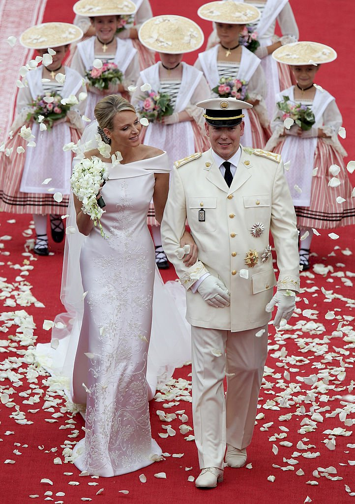 MONACO - JULY 02: Princess Charlene of Monaco and Prince Albert Of Monaco smile as they leave the palace after the religious ceremony of the Royal Wedding of Prince Albert II of Monaco to Charlene Wittstock in the main courtyard at Prince's Palace on July 2, 2011 in Monaco, Monaco. The Roman-Catholic ceremony follows the civil wedding which was held in the Throne Room of the Prince's Palace of Monaco on July 1. With her marriage to the head of state of the Principality of Monaco, Charlene Wittstock will become Princess consort of Monaco and gain the title, Princess Charlene of Monaco. Celebrations including concerts and firework displays are being held across several days, attended by a guest list of global celebrities and heads of state. (Photo by Andreas Rentz/Getty Images)