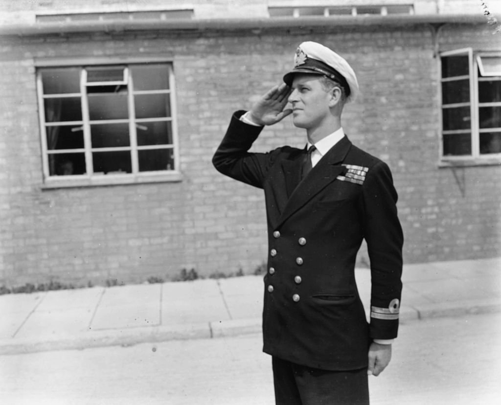 Philip Mountbatten, prior to his marriage to Princess Elizabeth, saluting as he resumes his attendance at the Royal Naval Officers School. | Source: Getty Images