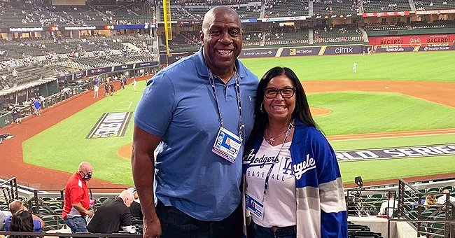 Magic Johnson & His Wife Cookie Hug as They Pose at a Stadium While Supporting the Dodgers