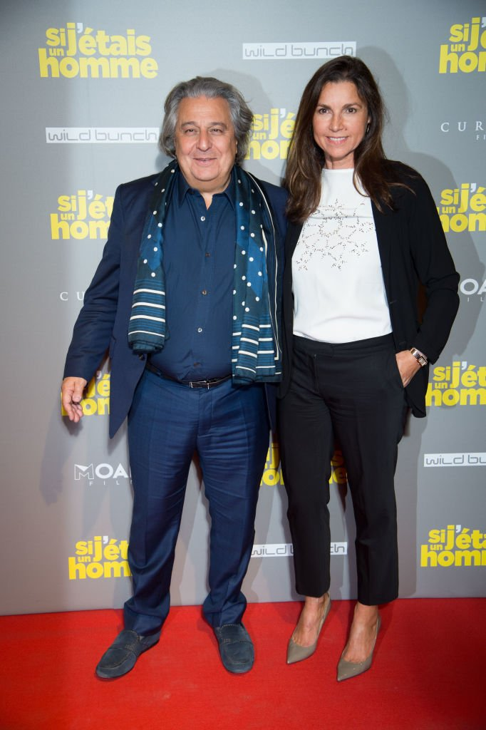 Christian Clavier et sa chérie Isabelle de Araujo. | Photo : Getty Images