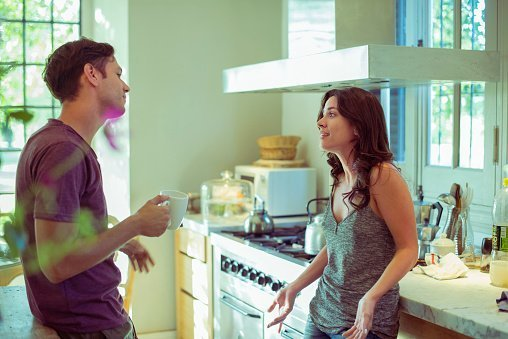 Photo of a Couple having a discussion in the kitchen  | Photo: Getty Images