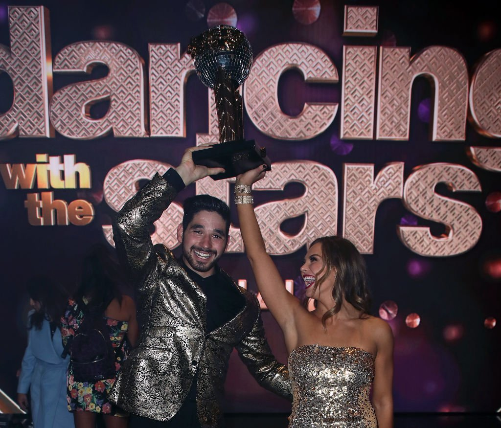 "Alan Bersten and Hannah Brown pose at ""Dancing with the Stars"" Season 28 Finale at CBS Television City 