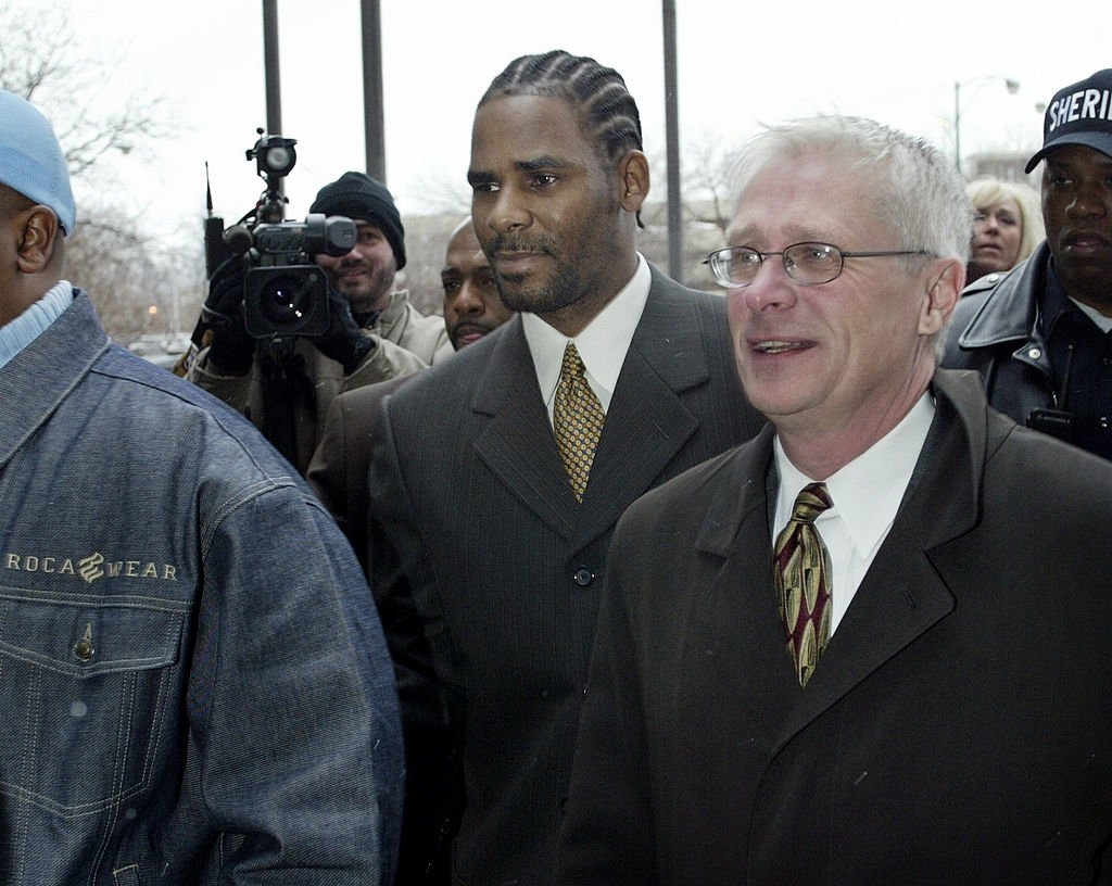 R. Kelly heads to court December 20, 2002 in Chicago, Illinois. He faced 21 counts of child pornography. | Source: GettyImages