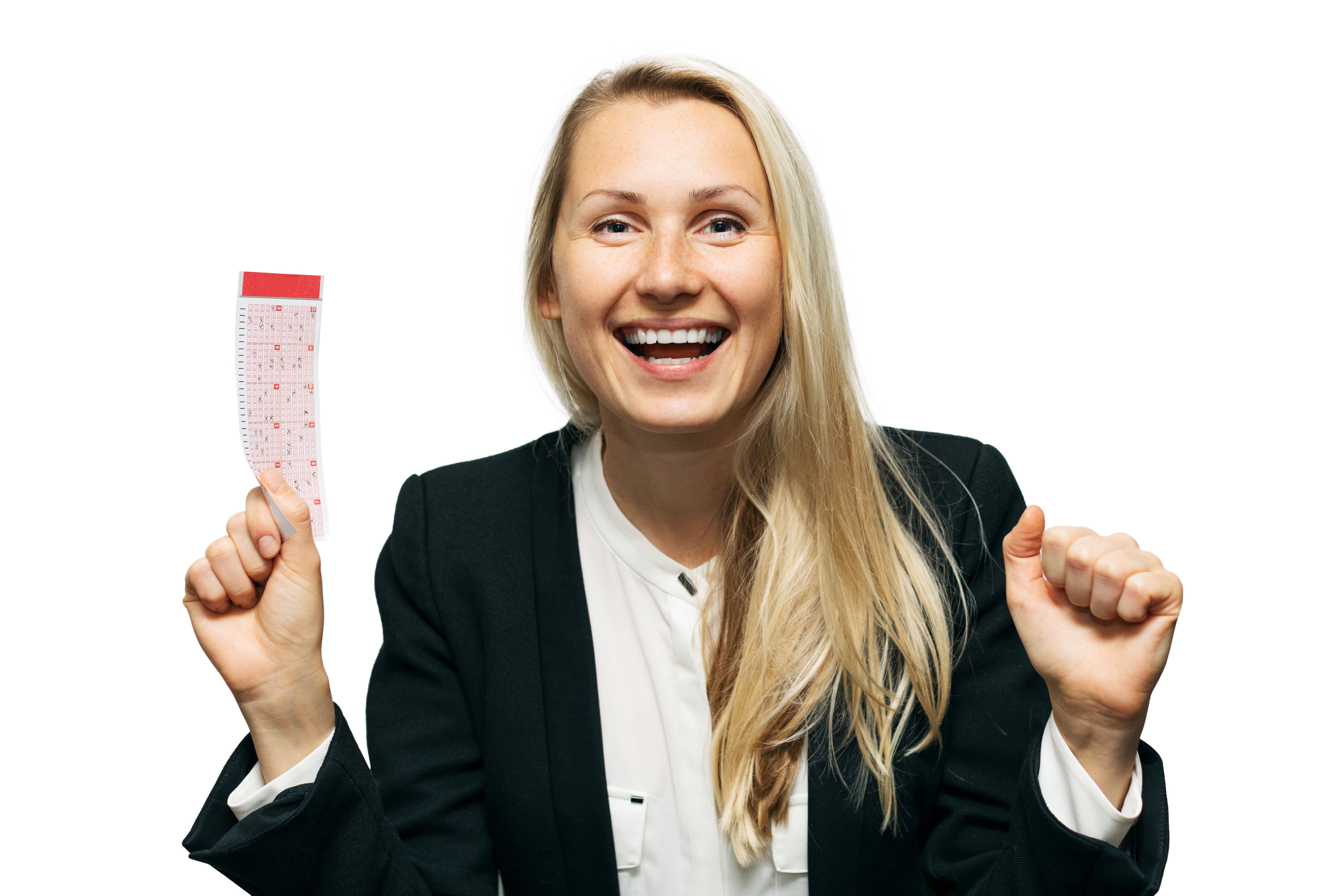 An ecstatic woman with a smile on her face holding a lottery ticket. | Photo: Shutterstock.