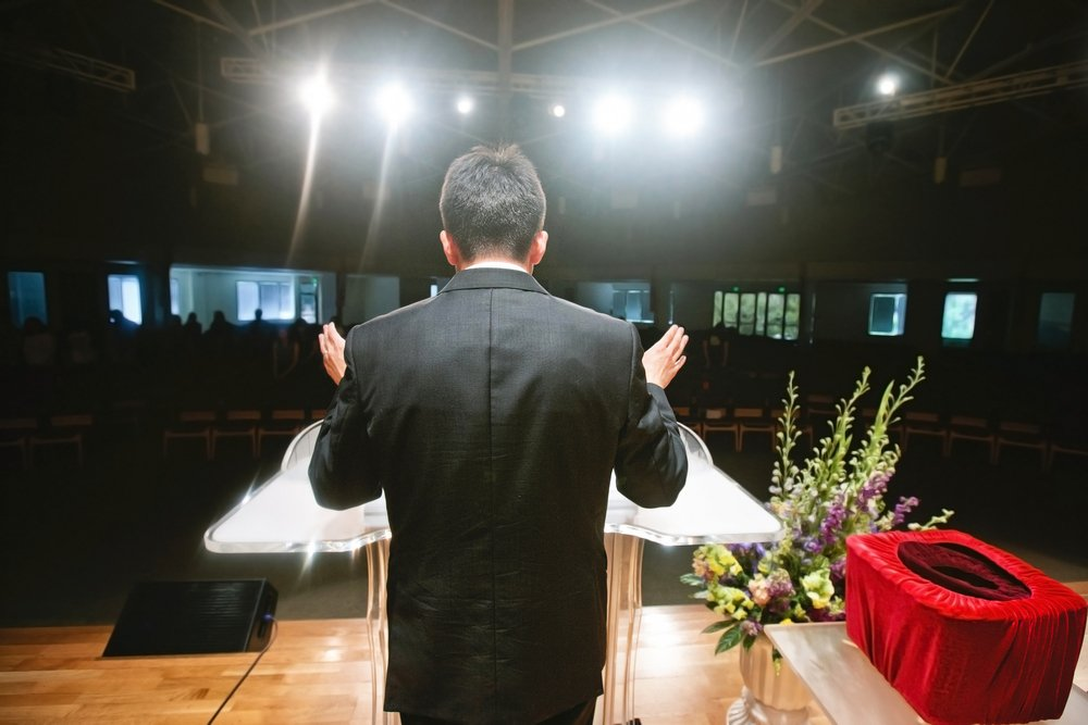 A pastor preaching to his congregation. | Photo: Shutterstock.