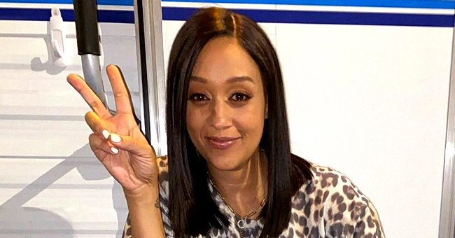 Tia Mowry's Son Cree Is Almost As Tall As Her Looking Dapper in Cream Suit in Photos with Mom