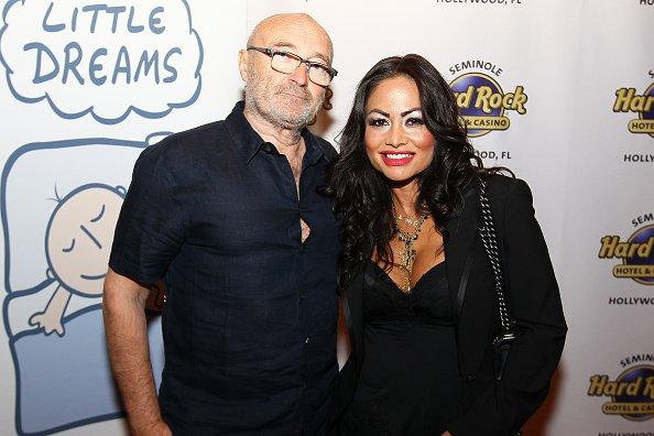 Phil Collins et Orianne Cevey assistent à la conférence de presse de la fondation Little Dreams au LBar du Seminole Hard Rock Hotel & Casino Hollywood le 4 mars 2016 à Hollywood. | Photo : Getty Images