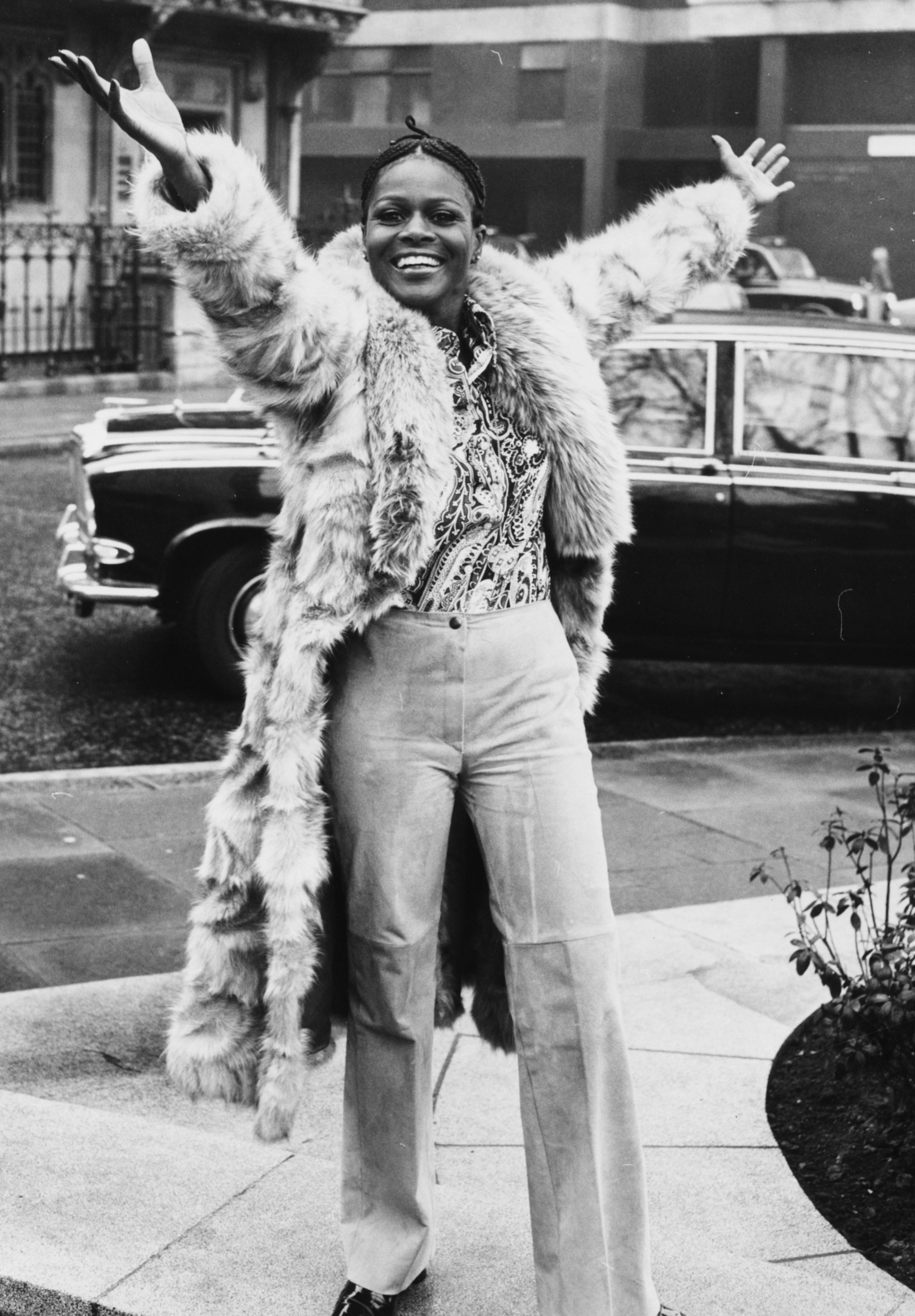 Cicely Tyson smiling and raising her arms in the air during a visit to London, February 19, 1973.| Source: Getty Images