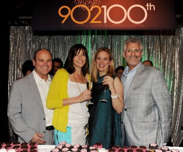 David Stapf, President, CBS Television Studios,and other executive producers pose at the 100th episode celebration of The CW's '90210' | Photo: Getty Images
