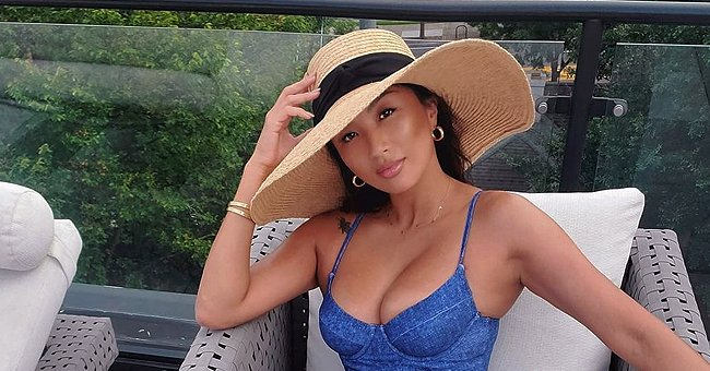 Check Out Jeannie Mai's Fit Figure on Display in a Denim Belted Swimsuit & Straw Hat (Photos)