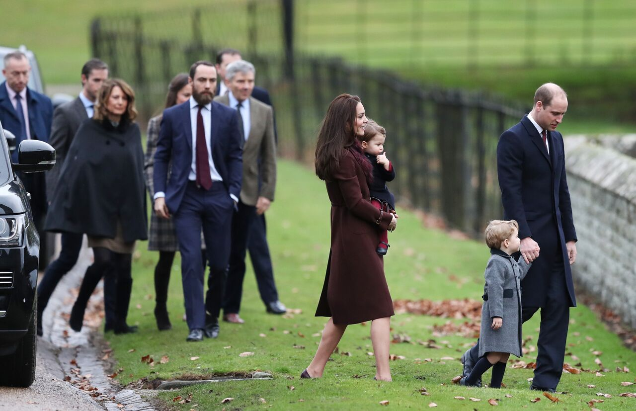 Catherine, Duchess of Cambridge and Prince William, Duke of Cambridge (R), Prince George of Cambridge, Princess Charlotte of Cambridge followed by Carole, James and Michael Middleton arrive to attend the service at St Mark's Church on Christmas Day in Bucklebury, Berkshire | Photo: Getty Images