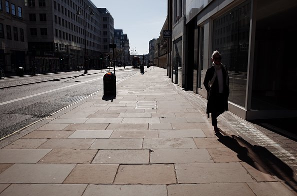 A woman walks along a near-deserted Strand in London, England, on March 24, 2020 | Photo:Getty Images