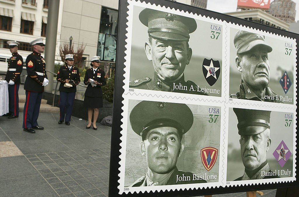 """The U.S. Postal Service issued a commemorative stamp series called """"Distinguished Marines."""" It features U.S. Marines Lewis B. Puller, Daniel J. Daly, John Basilone and John A. Lejeune   Source: Getty Images"""