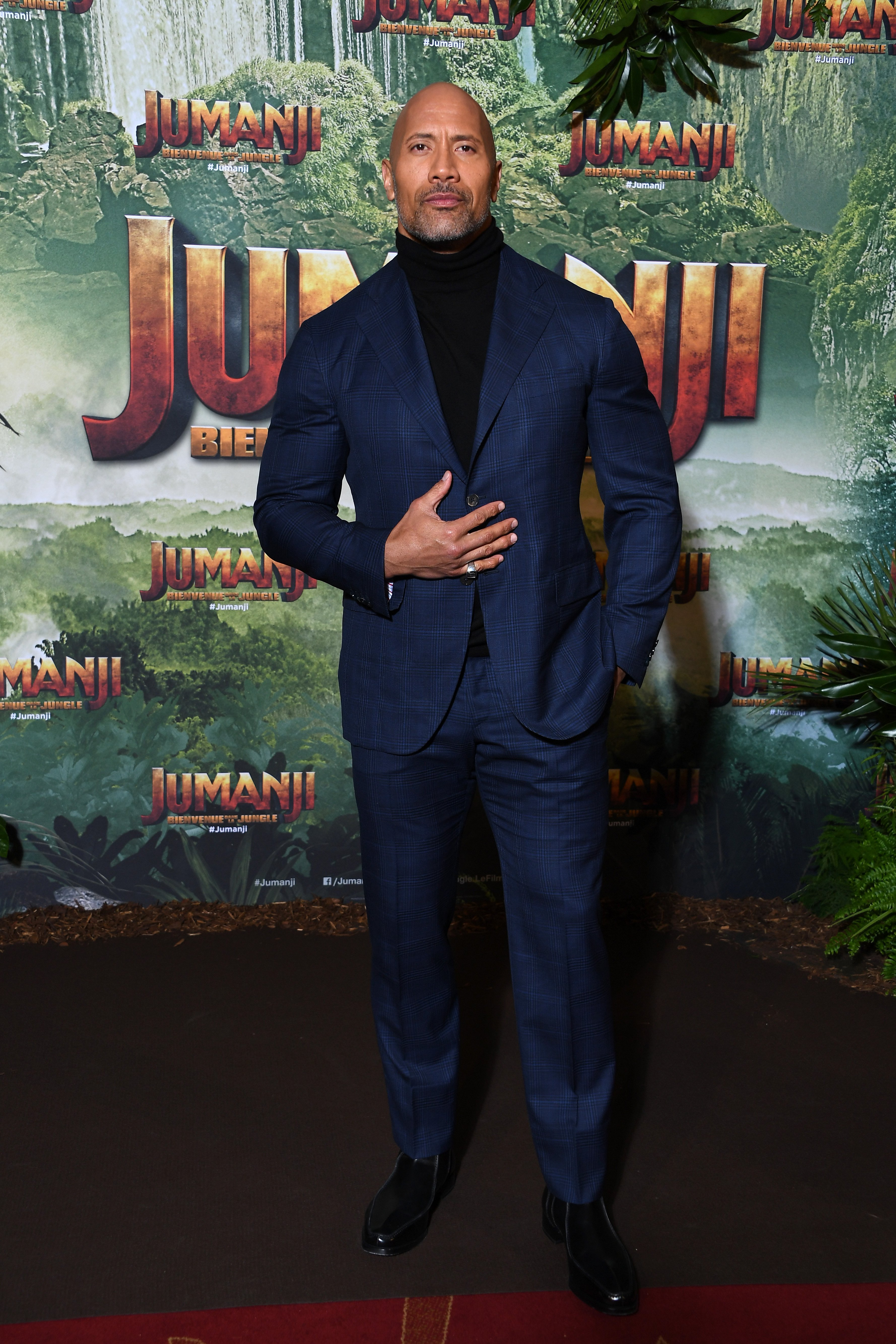 """Dwayne Johnson attends the premiere of """"Jumanji: Welcome to the Jungle"""" in Paris, France on December 5, 2017 