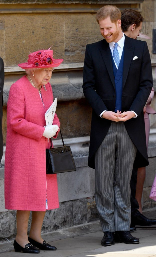 Queen Elizabeth II and Prince Harry, Duke of Sussex attend the wedding of Lady Gabriella Windsor and Thomas Kingston at St George's Chapel. | Photo: Getty Images