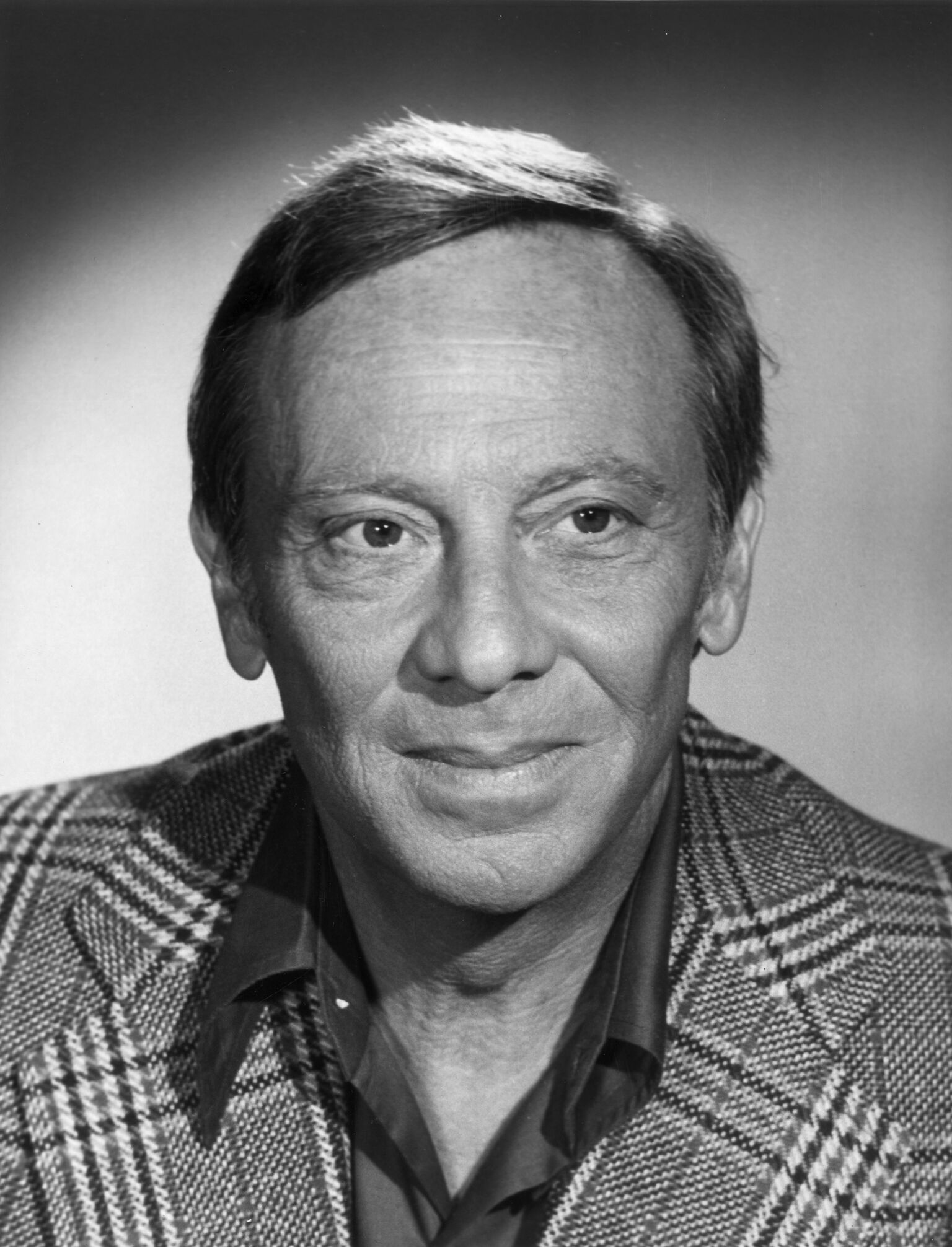 Studio headshot portrait of American actor Norman Fell (1924-1998), wearing a houndstooth blazer. | Getty Images