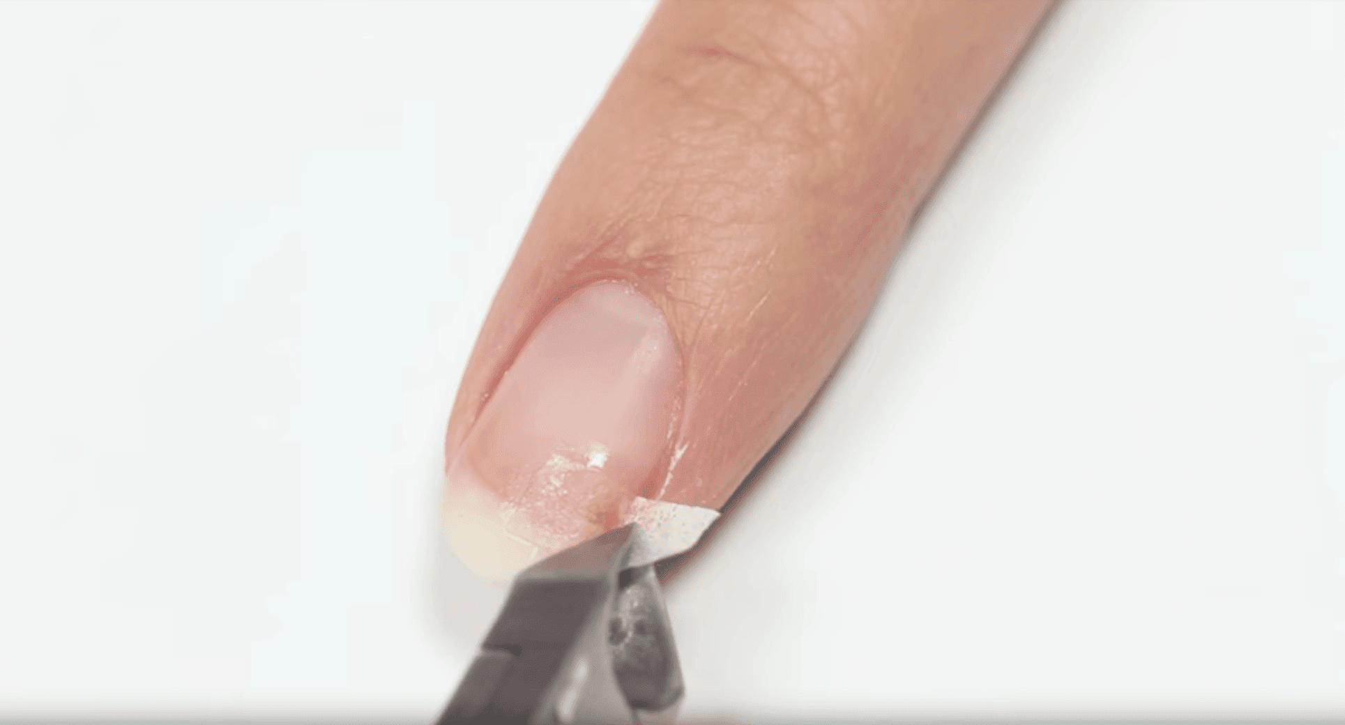 Clipping the excess. I Image: YouTube/ HannahRoxNails.