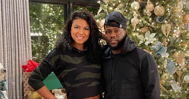Kevin Hart and Wife Eniko Pose Next to Christmas Tree and Beautifully Wrapped Gifts in a Snap