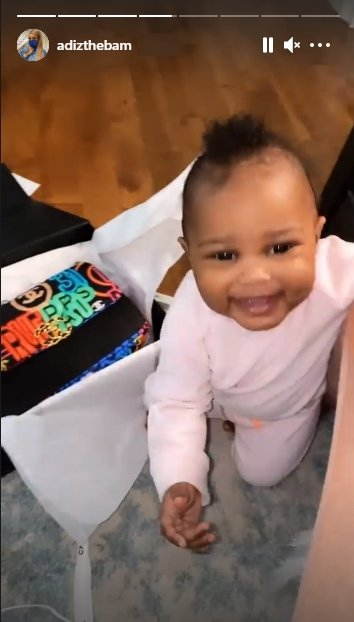 Lil Scrappy & Bambi Benson's daughter Xylo flashes a huge smile while playing with a Chanel box. | Source: Instagram.com/adizthebam