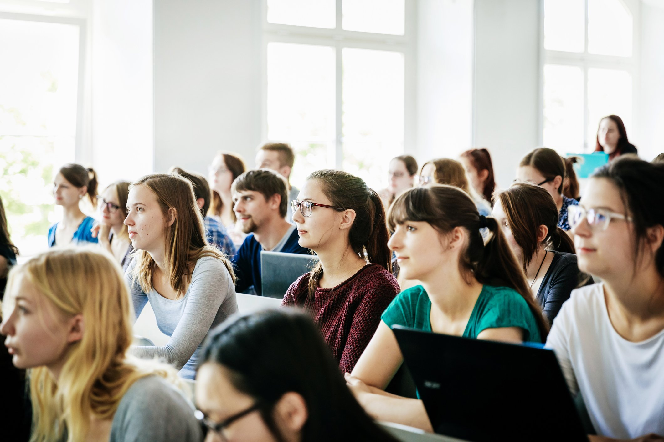 A group of students listening and concentrating on their tutor during a lecture at university.   Photo: Getty Images