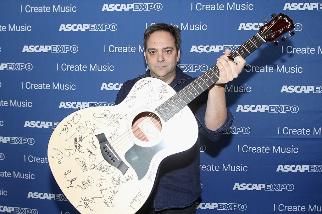 """Adam Schlesinger poses with a #StandWithSongwriters guitar, during the 2016 ASCAP """"I Create Music"""" EXPO on April 30, 2016 in Los Angeles, California 