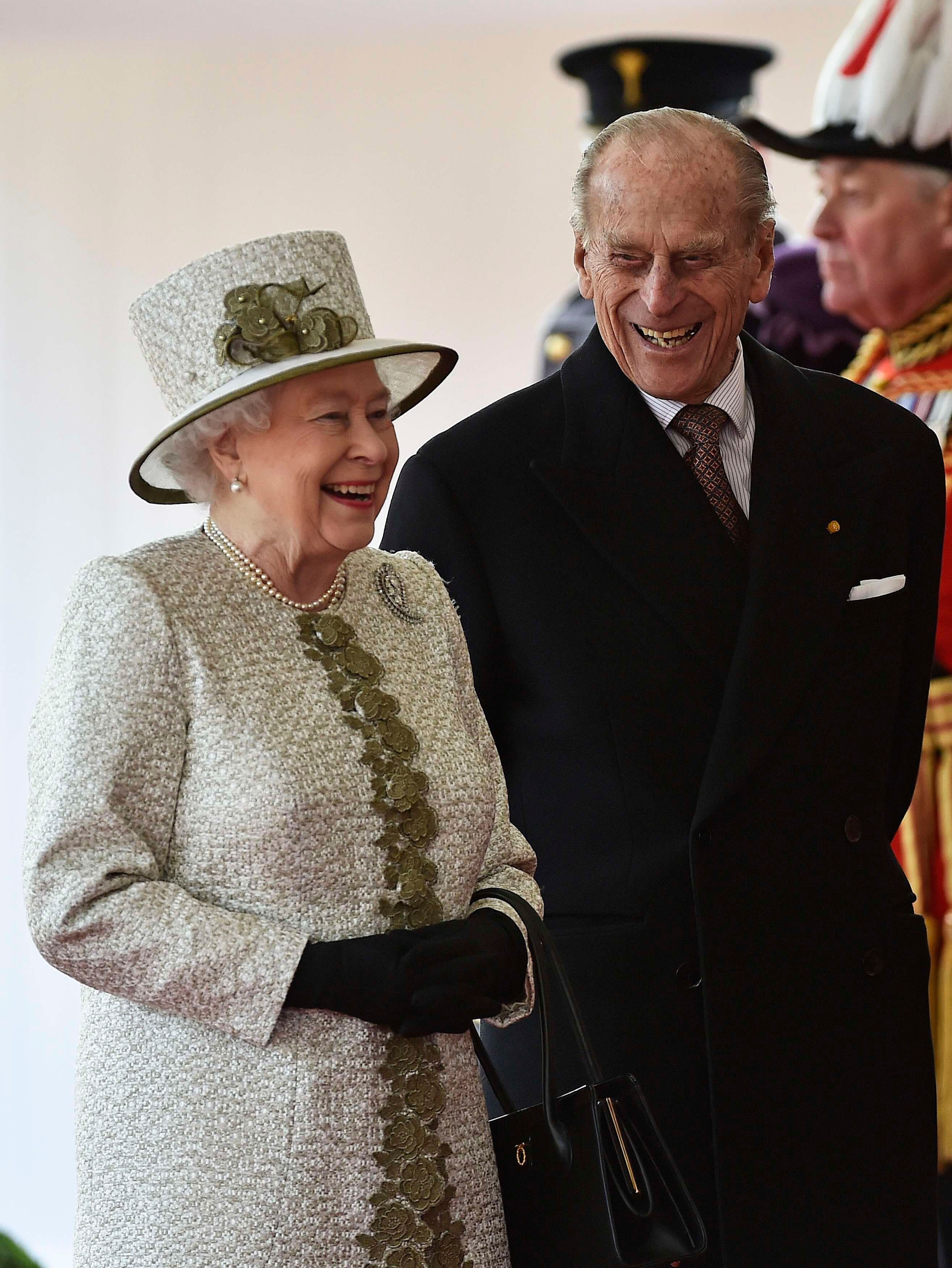 Queen Elizabeth II and Prince Philip, Duke of Edinburgh laugh during a ceremonial welcome for the State Visit of The President of The United Mexican, Senor Enrique Pena Nieto and Senora Rivera at Horse Guards Parade. | Source: Getty Images