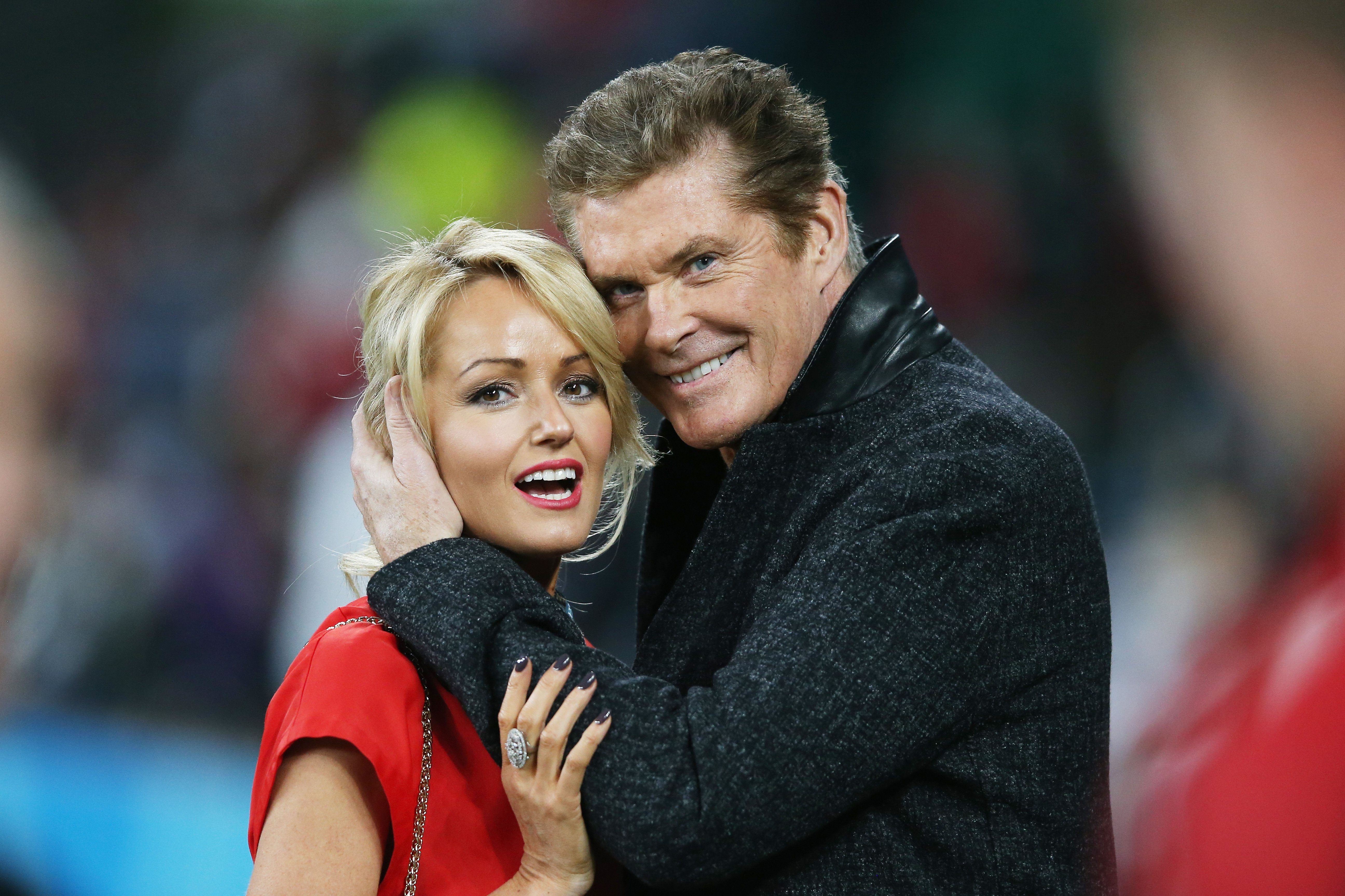 David Hasselhoff hugs welsh girlfriend Hayley Roberts during the 2015 Rugby World Cup Pool A match between England and Wales at Twickenham Stadium on September 26, 2015, in London, United Kingdom. | Source: Getty Images.