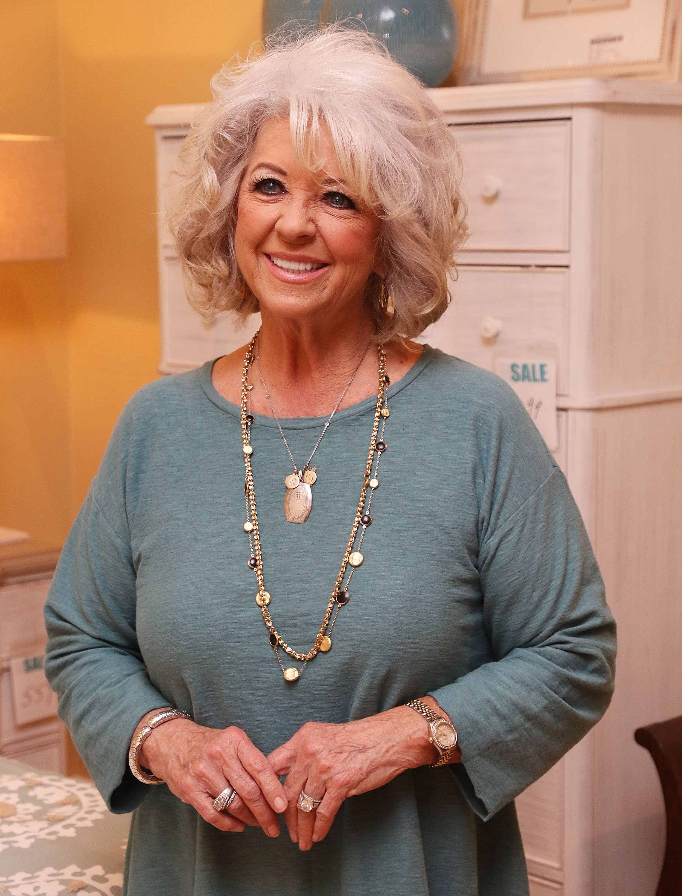 Paula Deen signing copies of her book during 'Cuts the Fat' Book Tour on January 30, 2016 in Boca Raton, Florida | Photo: Getty Images