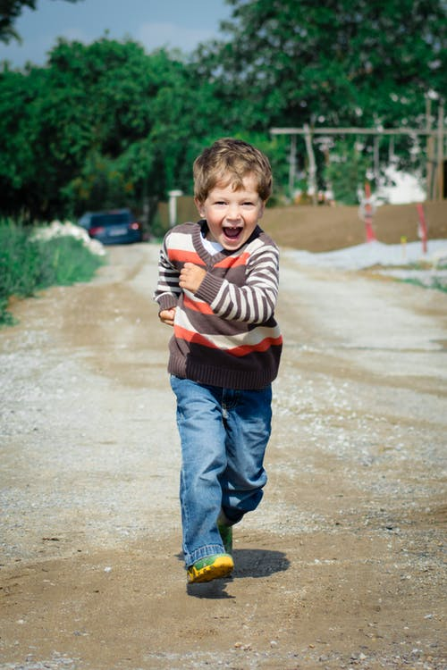 A young boy running in delight.   Source: Pexels
