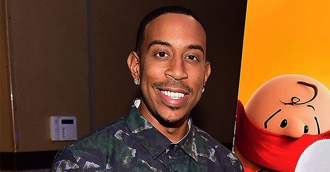 Ludacris' Wife Shows off Her Curves in a Top & Ripped Shorts on Vacation in Gabon with Her Kids