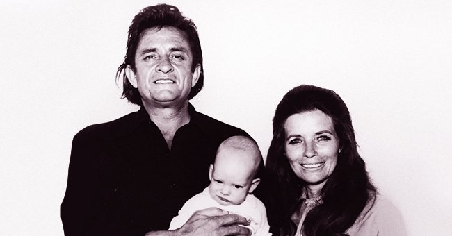 Johnny Cash and June Carter smile with their baby. | Source: Getty Images