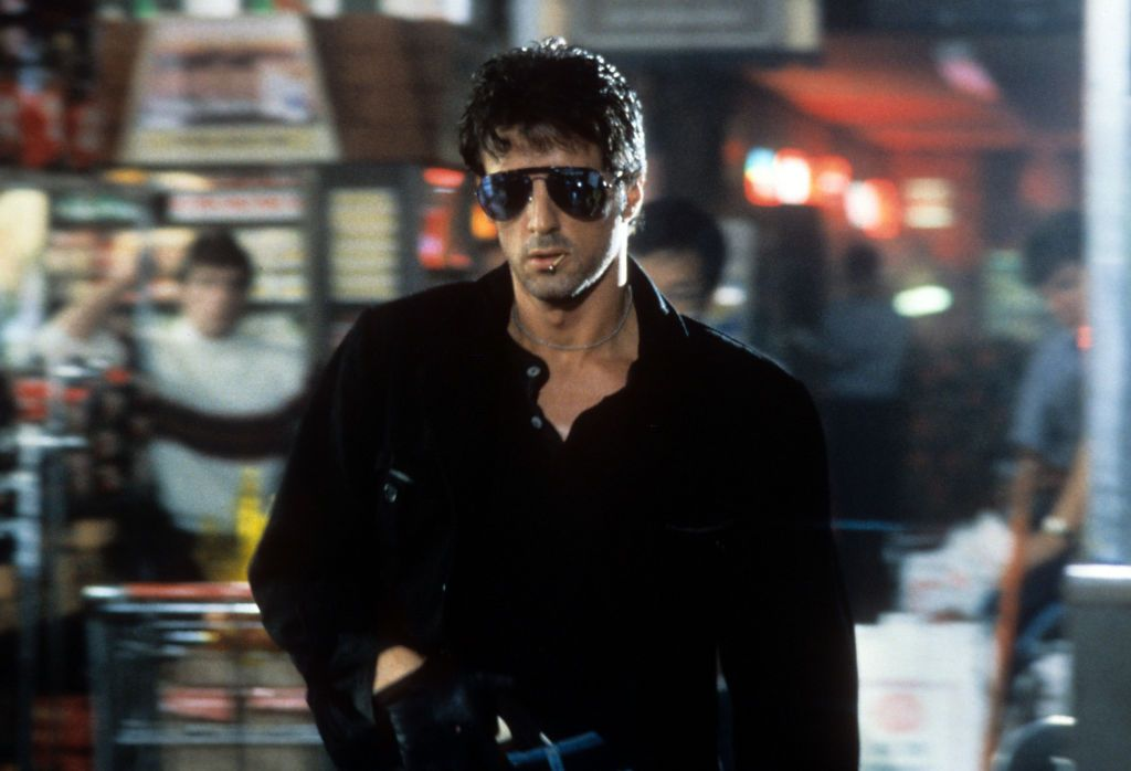 """Sylvester Stallone during a scene taken from the film """"Cobra,"""" 1986. 