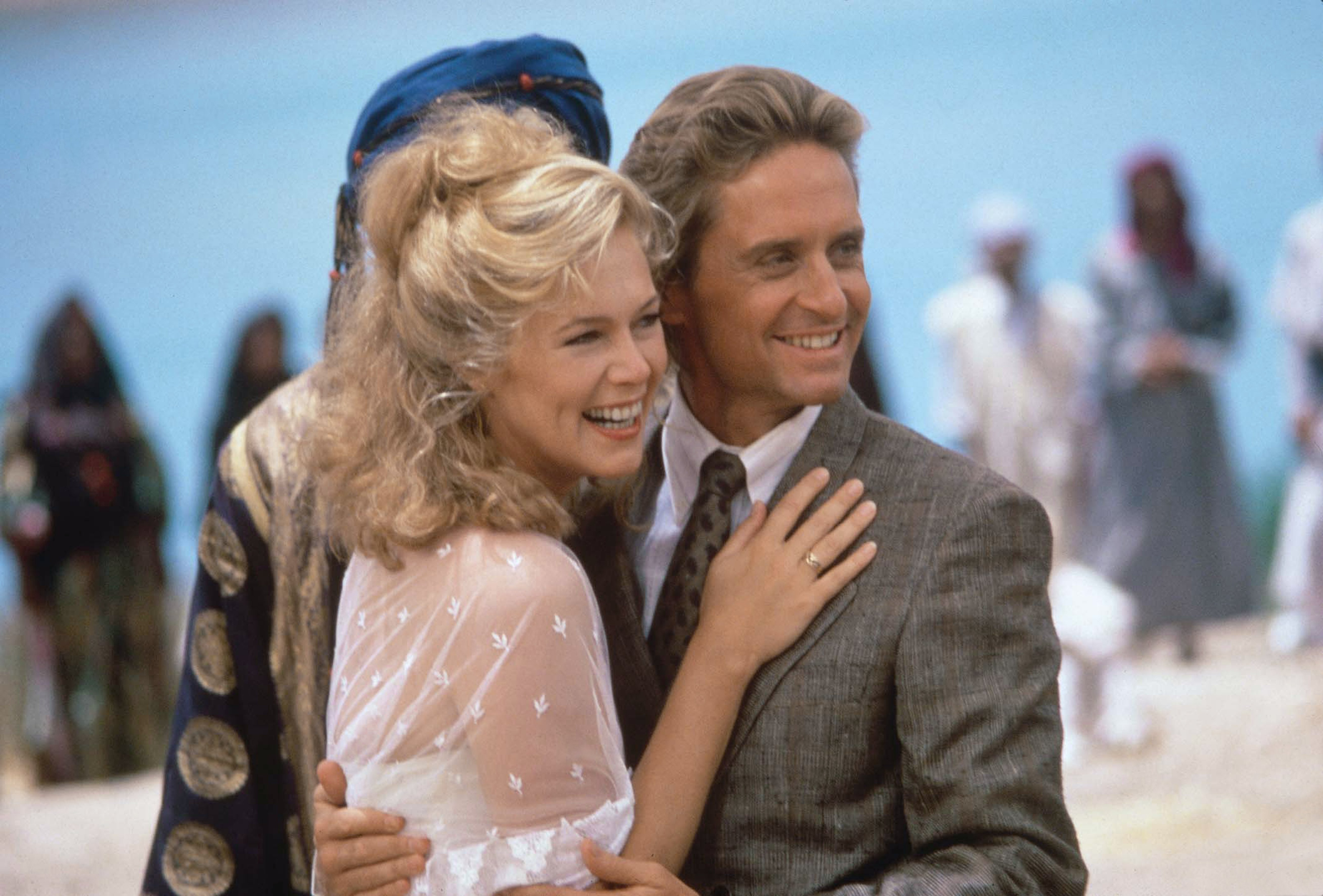 Michael Douglas and  Kathleen Turner on the set of The Jewel of the Nile directed by Lewis Teague.   Source: Getty Images