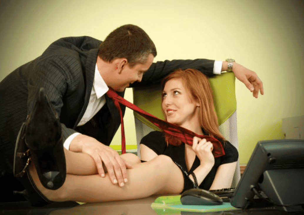 Woman flirts with a man while at work in her office | Source: Getty Images