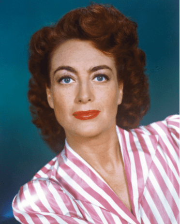 American actress Joan Crawford (1904 - 1977) wearing a pink and white striped blouse, circa 1945. | Source: Getty Images