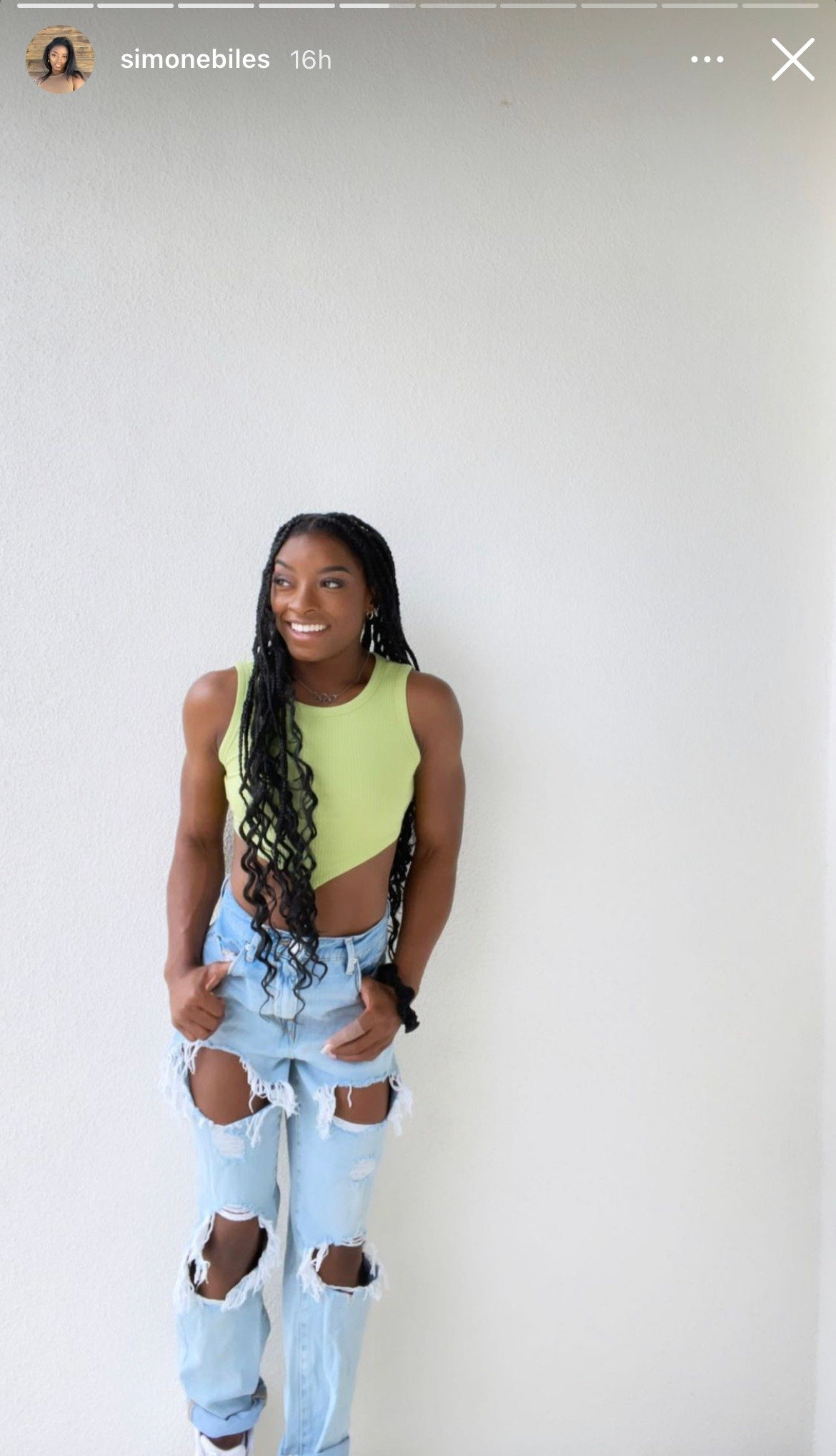Simone Biles shows off her chiseled body in green top and ripped blue jeans.   Photo: Instagram/Simonebiles