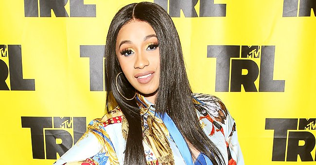 Cardi B Gushes over Daughter Kulture as She Holds Her Dressed in a Pink Tutu with Gold Earrings