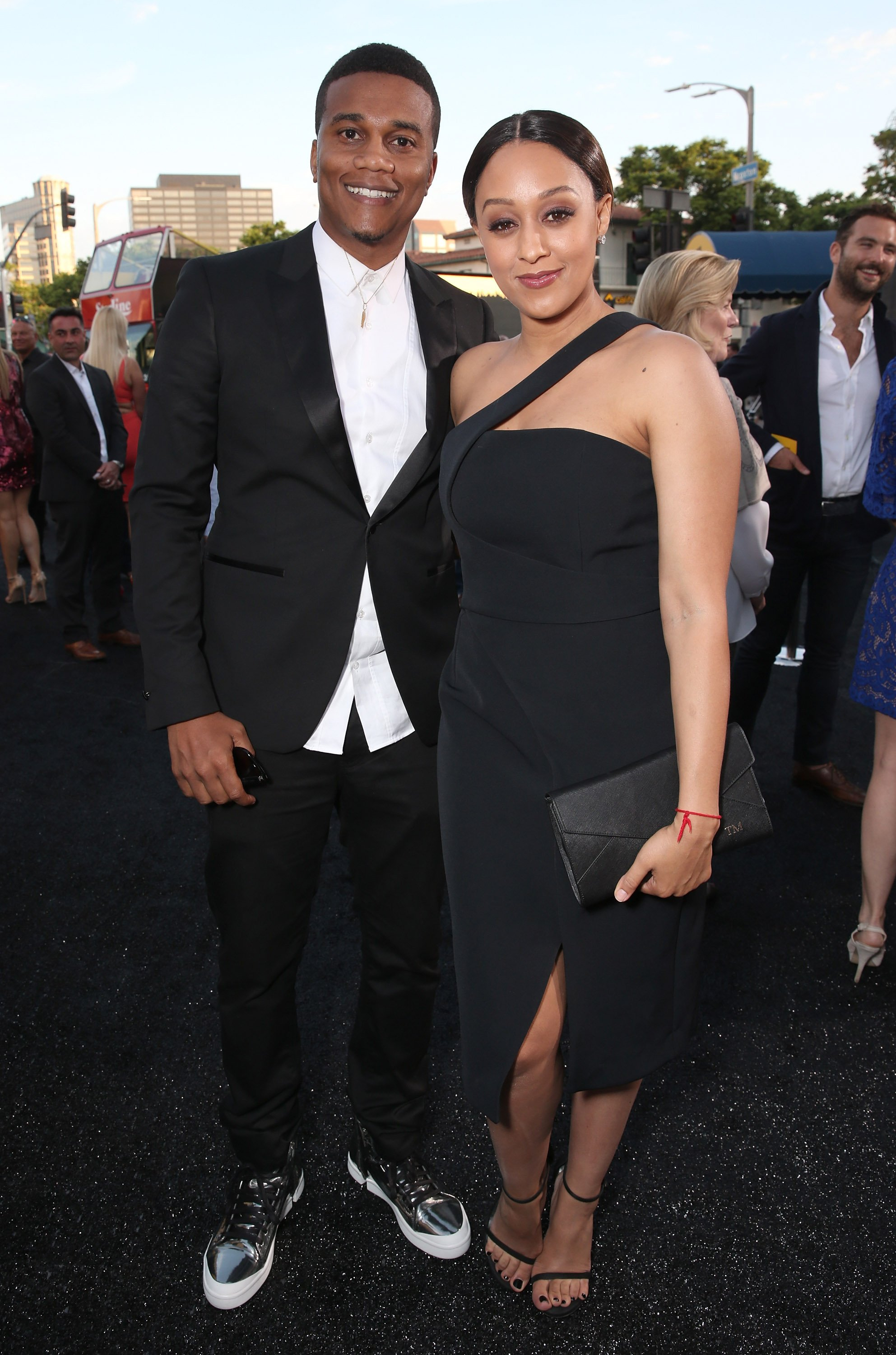 "Cory Hardrict & Tia Mowry-Hardrict attend the premiere of ""Central Intelligence"" on June 10, 2016 