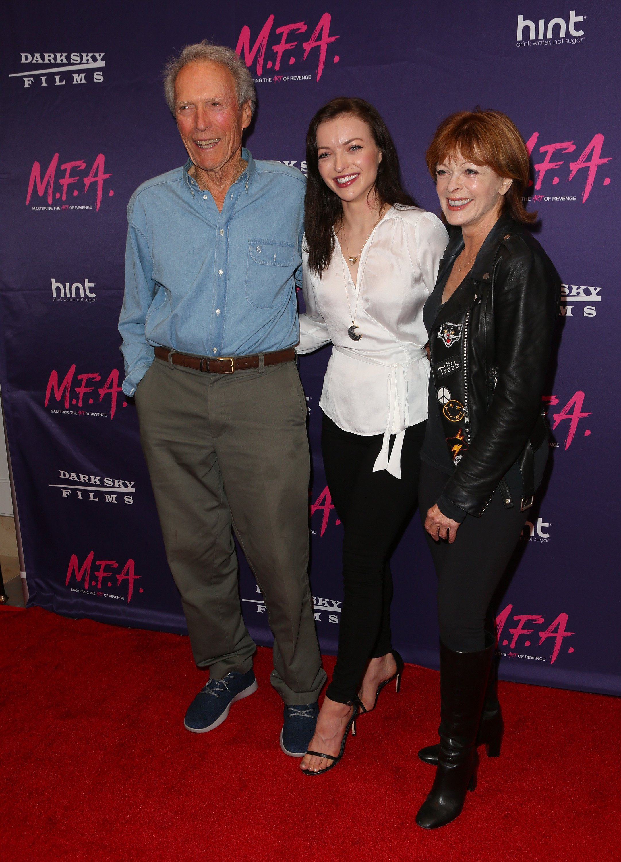 "Francesca Eastwood with her father, Clint Eastwood, and her mother, Frances Fisher at the premiere on Francesca's movie, ""M.F.A."", October 2017. 