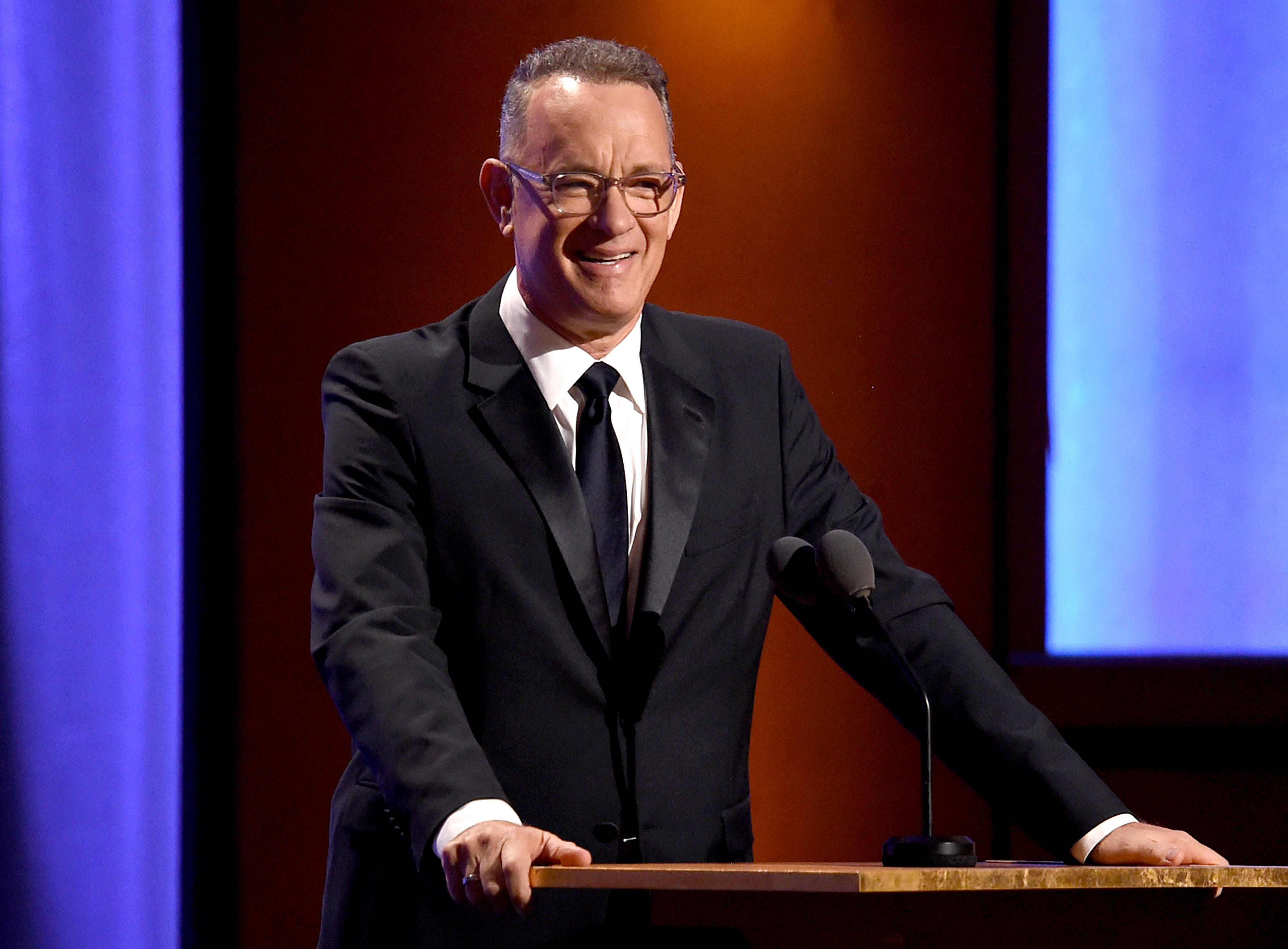 Tom Hanks speaking onstage during the Academy of Motion Picture Arts and Sciences' 10th annual Governors Awards at The Ray Dolby Ballroom at Hollywood & Highland Center in Hollywood, California | Photo: Kevin Winter/Getty Images