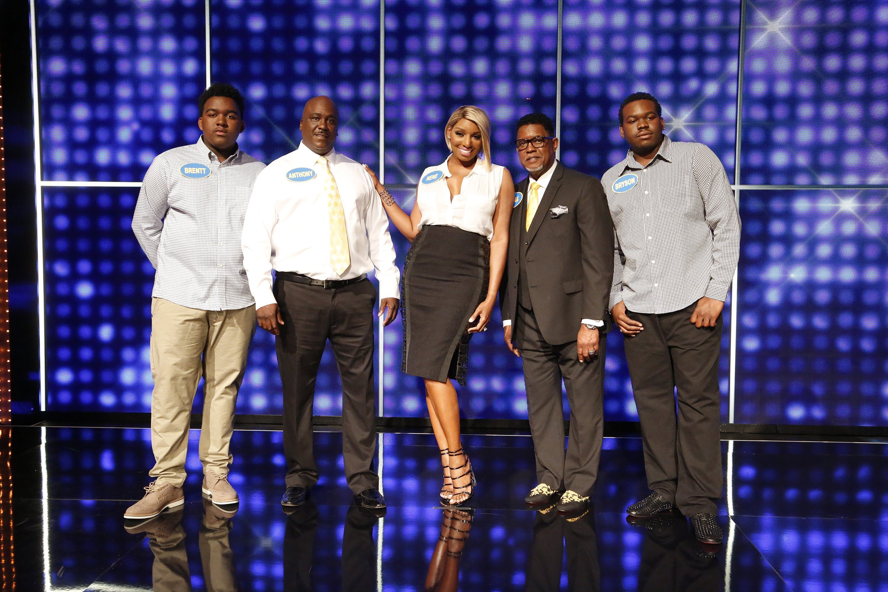 "Brentt Leakes, Nene Leakes, and Bryson Bryant duing an appearance on ""Celebrity Family Feud"" 