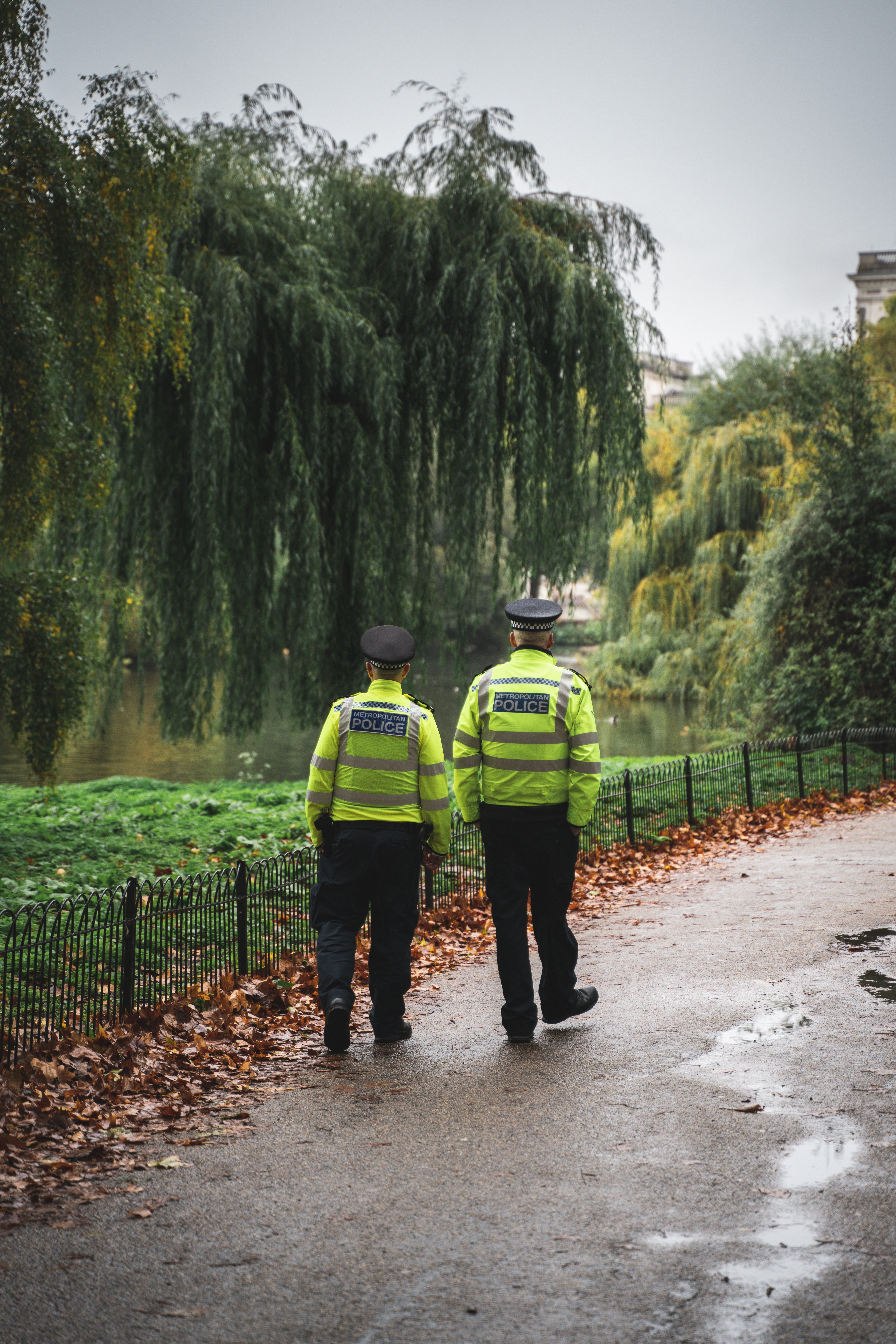 Two police officers walking along a park   Photo: Pexels