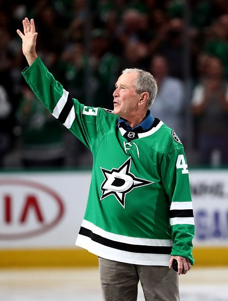 Former President George W. Bush walks on the ice before a game between the Boston Bruins and the Dallas Stars at American Airlines Center on October 03, 2019 in Dallas, Texas | Photo: Getty Images